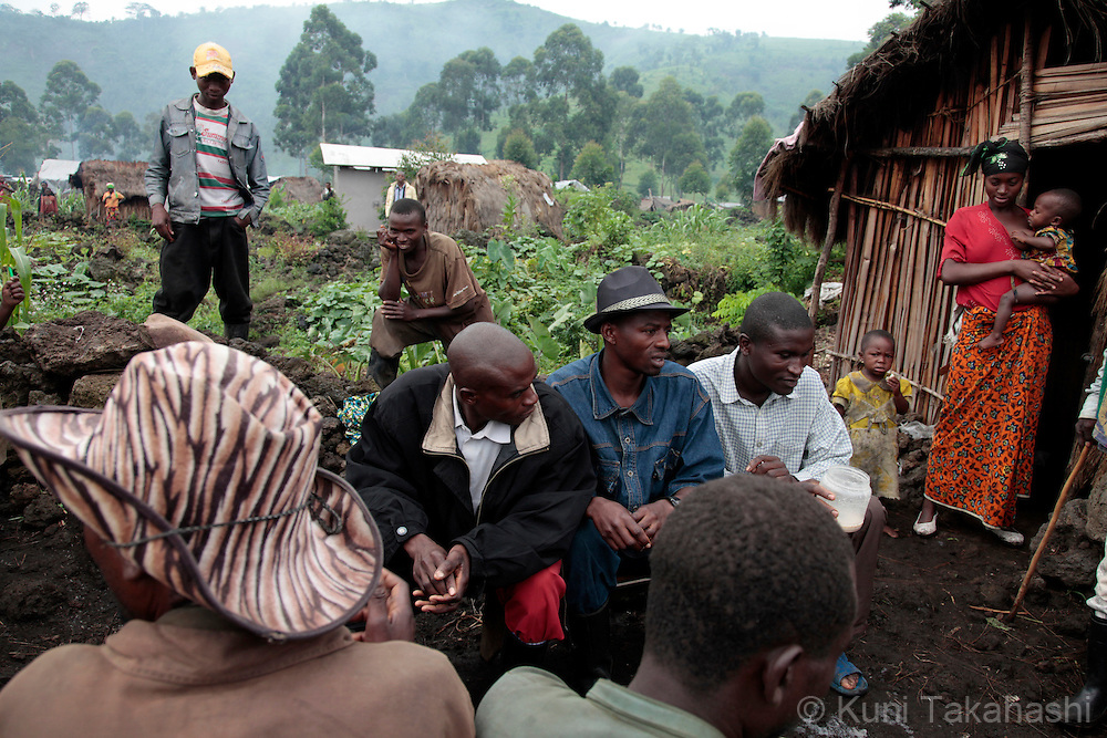 People gather at Mungote camp for IDPs (Internally Displaced Persons) in Kichanga, 70km north of Goma, DRC on April 25, 2010. The long war had involved 9 African nations and claimed an estimated three million lives as a result of fighting or disease and malnutrition..Photo by Kuni Takahashi