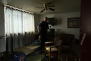 (Gabe Green   The Daily World)<br /> <br /> Sergeant Keith Dale of the Aberdeen Police Department searches a room for trespassers at the Thunderbird Motel Friday morning.