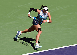 March 8, 2019 - Indian Wells, CA, U.S. - INDIAN WELLS, CA - MARCH 08: Garbine Muguruza (ESP) runs towards the net during a match at the BNP Paribas Open played at the Indian Wells Tennis Garden in Indian Wells, CA. (Photo by John Cordes/Icon Sportswire) (Credit Image: © John Cordes/Icon SMI via ZUMA Press)