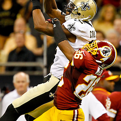 September 9, 2012; New Orleans, LA, USA; Washington Redskins cornerback Josh Wilson (26) breaks up a pass to New Orleans Saints wide receiver Marques Colston (12) during the second half of a game at the Mercedes-Benz Superdome. The Redskins defeated the Saints 40-32. Mandatory Credit: Derick E. Hingle-US PRESSWIRE