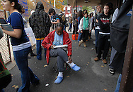 PHILADELPHIA - NOVEMBER 4: Ireleane Hatchell of Philadelphia, Pennsylvania sits on a chair while she waits to vote on Election Day November 4, 2008 in Philadelphia, Pennsylvania. Hundreds of Temple University students waited more then two hours to cast their vote in what is expected to be a record turnout at the polls. (Photo by William Thomas Cain/Getty Images)