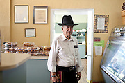 Rabbi Joseph Kaufman (left), a 39-year Miami Beach resident, stands in his friend Melvin Safra's restaurant, Bagel Time, in Miami Beach, Florida July 17, 2011. ..Kendrick Brinson/LUCEO