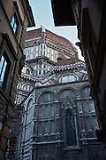 A narrow street approaching  the Basilica di Santa Maria del Fiore (duomo) in Florence.