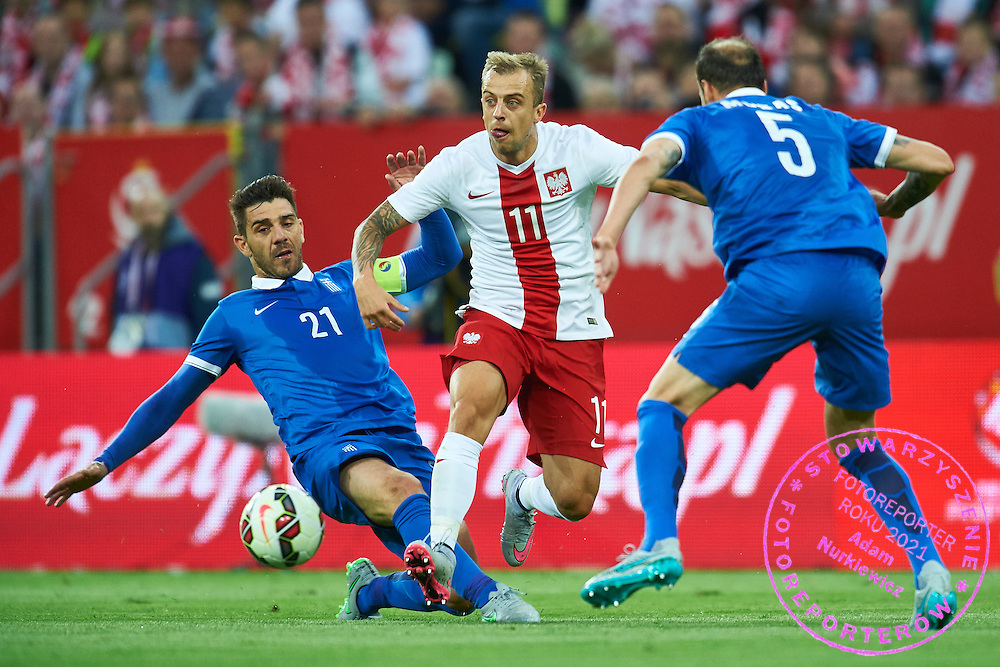 (C) Kamil Grosicki from Poland fights for the ball with (L) Alexandros Tziolis and Evangelos Moras both from Greece during international friendly soccer match between Poland and Greece at PGE Arena Stadium on June 16, 2015 in Gdansk, Poland.<br /> Poland, Gdansk, June 16, 2015<br /> <br /> Picture also available in RAW (NEF) or TIFF format on special request.<br /> <br /> For editorial use only. Any commercial or promotional use requires permission.<br /> <br /> Adam Nurkiewicz declares that he has no rights to the image of people at the photographs of his authorship.<br /> <br /> Mandatory credit:<br /> Photo by &copy; Adam Nurkiewicz / Mediasport