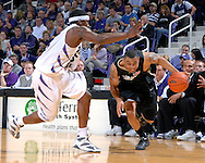 Colorado guard Xavier Silas (R) drives against pressure from Kansas State forward David Hoskins (L) in the first half at Bramlage Coliseum in Manhattan, Kansas, February 10, 2007.  K-State beat Colorado 78-59.