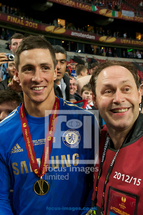Picture by Ian Wadkins/Focus Images Ltd +44 7877 568959.15/05/2013.Fernando Torres of Chelsea poses for a picture with a member of the media after the UEFA Europa League Final at Amsterdam Arena, Amsterdam.