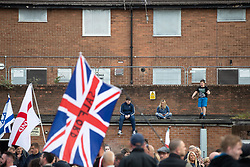 © Licensed to London News Pictures . 22/05/2019. Salford, UK. Former EDL leader Stephen Yaxley-Lennon (aka Tommy Robinson ) holds a campaign rally at the derelict Mocha Parade shopping precinct in Salford , opposed by anti-fascists . Yaxley-Lennon is running for a seat in the European Parliament representing the North West of England . Photo credit: Joel Goodman/LNP