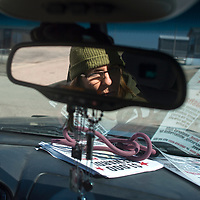 Angela Stell drives around neighborhoods on the south side of Gallup Wednesday looking for the missing dog Rasha.