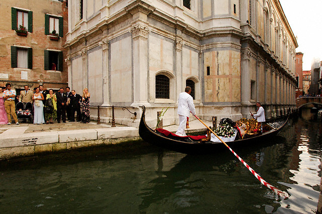 August 2005, Venice, Italy --- Bride and Groom Leaving Their Wedding by Gondola --- Image by © Owen Franken/Corbis