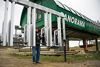 """Marketing Director Mike Roth showing the new """"RFID"""" radio frequency identification readers located at the base of the Panorama lift at Gunstock on Wednesday morning.  (Karen Bobotas/for the Laconia Daily Sun)"""