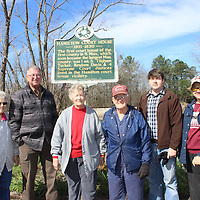 RAY VAN DUSEN/BUY AT PHOTOS.MONROECOUNTYJOURNAL.COM<br /> From left, Mary Carter, Billy Kirkpatrick, Edna and Richard Cox, Joseph Richardson and Nancy Payne stand in front of a newly placed historical sign commemorating Hamilton's former courthouse. After years of being stored, the sign now has a new place at the Hamilton Community Center.