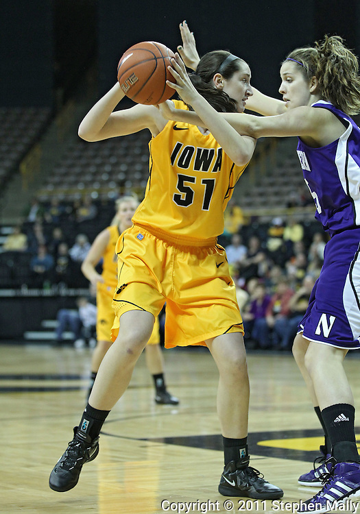 December 30, 2011: Iowa Hawkeyes center Bethany Doolittle (51) works against Northwestern Wildcats forward Alex Cohen (5) during the NCAA women's basketball game between the Northwestern Wildcats and the Iowa Hawkeyes at Carver-Hawkeye Arena in Iowa City, Iowa on Wednesday, December 30, 2011.