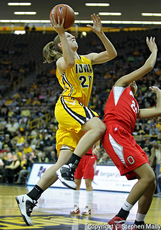 January 08 2010: Iowa forward Kelly Krei (20) puts up a shot over Ohio St. forward Martina Ellerbe (23) during the first half of an NCAA womens college basketball game at Carver-Hawkeye Arena in Iowa City, Iowa on January 08, 2010. Iowa defeated Ohio State 89-76.