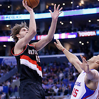 12 February 2014: Portland Trail Blazers center Robin Lopez (42) goes for the jumper over Los Angeles Clippers center Ryan Hollins (15) during the Los Angeles Clippers 122-117 victory over the Portland Trail Blazers at the Staples Center, Los Angeles, California, USA.