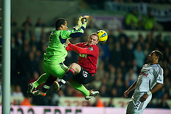 19.11.2011, Liberty Stadion, Swansea, ENG, PL, Swansea City vs Manchester United, 12. Spieltag, im Bild Swansea City's goalkeeper Michael Vorm in action against Manchester United'm Wayne Rooney during the Premiership match at the Liberty Stadium. (Pic by David Rawcliffe/Propaganda). EXPA Pictures © 2011, PhotoCredit: EXPA/ Sportida/ David Rawcliff..***** ATTENTION - OUT OF ENG, GBR, UK *****