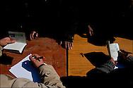 Inside Ben Gardane's house of culture where Egyptians refugees who succeeded to escape from Libya are seen resting protected by Tunisian army.  Plus de 140 000 réfugiés ont déjà quitté la Libye par la Tunisie ou l'Egypte et des milliers continuent d'arriver chaque jours. Vendredi 25 Février 2011, Ben Guerdane, Tunisie..© Benjamin Girette/IP3 press