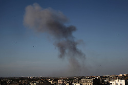 May 4, 2019 - Gaza, Palestine - Smoke rises following an Israeli airstrike in Beit Lahia in the northern Gaza Strip. Gaza militants fired a barrage of dozens of rockets at Israel, which responded with strikes that killed a Palestinian on Saturday, officials said, as a fragile ceasefire again faltered. (Credit Image: © Ramez Habboub/Pacific Press via ZUMA Wire)