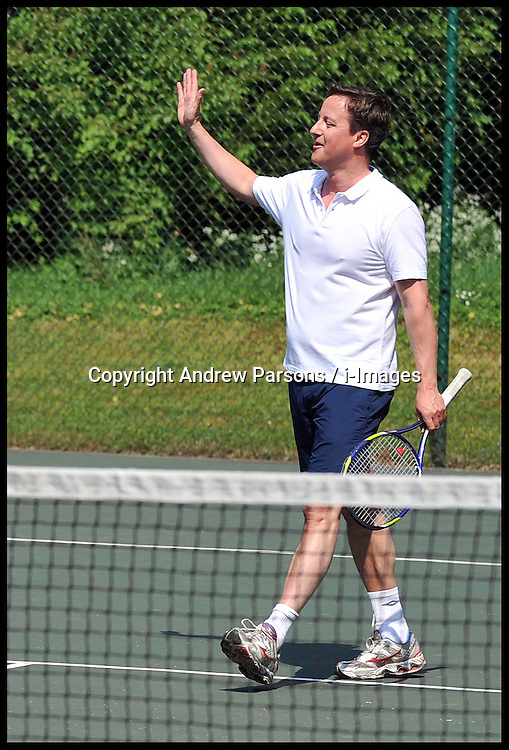 The Prime Minister David Cameron and Boris Becker play in a charity Tennis match at Chequers, Saturday April 30 2011. Photo By Andrew Parsons / i-Images.<br />