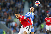 Brighton and Hove Albion forward Glenn Murray (17) battles for header with Manchester United Defender Chris Smalling during the Premier League match between Brighton and Hove Albion and Manchester United at the American Express Community Stadium, Brighton and Hove, England on 4 May 2018. Picture by Phil Duncan.