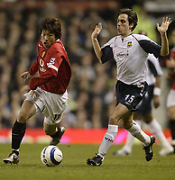 Photo: Aidan Ellis.<br /> Manchester United v West Ham United. The Barclays Premiership. 29/03/2006.<br /> United's Ji-Sung Park beats West Ham's Youssi Benayoun