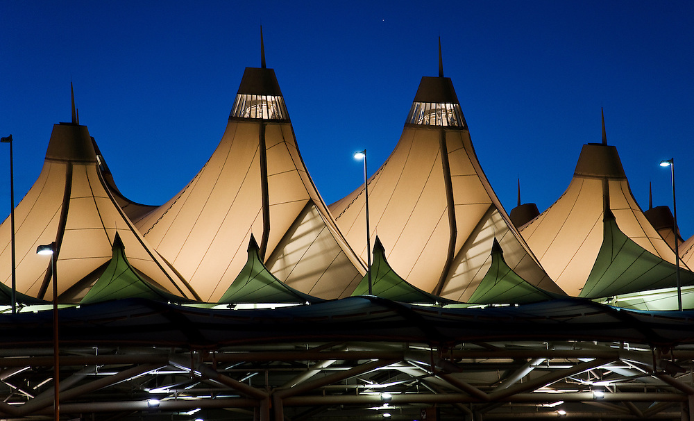 Denver International Airport's dramatic Jeppesen Terminal features a fabric catenary roof designed to evoke the nearby Rocky Mountains.
