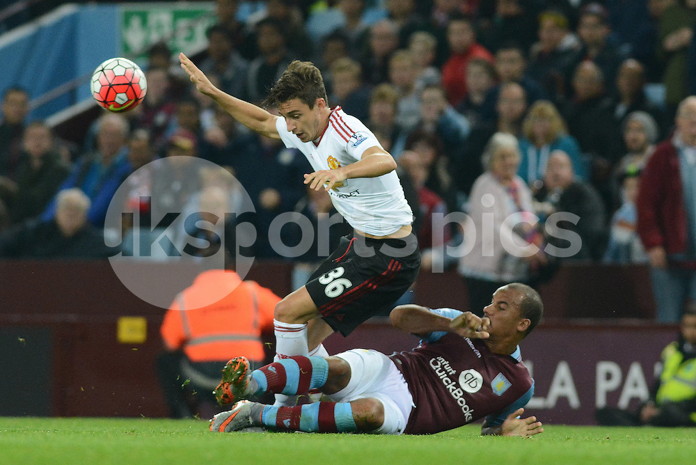Manchester United's Matteo Darmian and Aston Villa's Gabby Agbonlahor tussle for the ball during the Barclays Premier League match between Aston Villa and Manchester United at Villa Park, Birmingham, England on 14 August 2015. Photo by Garry Griffiths.