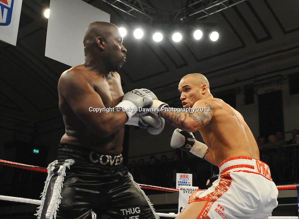Simon Vallily (pro debut- white shorts) defeats Simeon Cover at York Hall, Bethnal Green, London, UK on the 21st March 2013. Frank Warren Promotions. © Leigh Dawney Photography 2013.