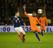 9th November 2017, Pittodrie Stadium, Aberdeen, Scotland; International Football Friendly, Scotland versus Netherlands; Holland's Quincy Promes and Scotland's Andrew Robertson