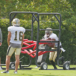 31 July 2009: New Orleans Saints FB Olaniyi Sobomehin (33) runs through the gauntlet during the opening day of New Orleans Saints training camp held at the team's practice facility in Metairie, Louisiana.