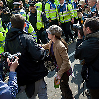 "London April 2nd 2009 (FILE IMAGE)  Picture shows an officer with his number hidden just seconds before allegedly swiping at the woman ( In the pic with cap) with the back of his hand and in the legs with the extendeble baton...***Standard Licence  Fee's Apply To All Image Use***.Marco Secchi /Xianpix. tel +44 (0) 845 050 6211. e-mail ms@msecchi.com or sales@xianpix.com.www.marcosecchi.com A police officer will be charged with assaulting a woman during the G20 demonstrations in London, the Crown Prosecution Service has said.Sergeant Delroy Smellie has been ordered to appear in court over the beating of Nicola Fisher.<br /> <br /> Prosecutors have decided there is ""sufficient evidence"" for him to be charged."