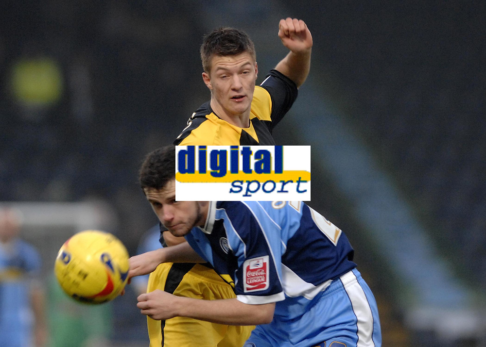 Photo: Richard Lane.<br />Wycombe Wanderers v Stockport County. Coca Cola League 2. 23/12/2006. <br />Wycombe's Stephen O'Halloran is challenged by Stockport's Anthony Pilkington.