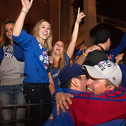 Chicago Cubs fans celebrating outside Wrigley Field winning the World Series from the Cleveland Indians in 7 games.<br />