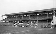 Player M. Dwyer falls with the ball still in his possession surrounded by Galway backs during the All Ireland Senior Gaelic Football final Kerry v. Galway in Croke Park on 27th September 1964. Galway 0-15 Kerry 0-10.