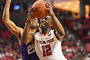 LUBBOCK, TX - MARCH 3: Keenan Evans #12 of the Texas Tech Red Raiders goes to the basket against Alex Robinson #25 of the TCU Horned Frogs during the game on March 3, 2018 at United Supermarket Arena in Lubbock, Texas. Texas Tech defeated TCU 79-75. Texas Tech defeated TCU 79-75. (Photo by John Weast/Getty Images) *** Local Caption *** Keenan Evans;Alex Robinson