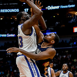 Oct 20, 2017; New Orleans, LA, USA; Golden State Warriors forward Draymond Green (23) is defended by New Orleans Pelicans forward Darius Miller (21) during the second quarter of a game at the Smoothie King Center. Mandatory Credit: Derick E. Hingle-USA TODAY Sports