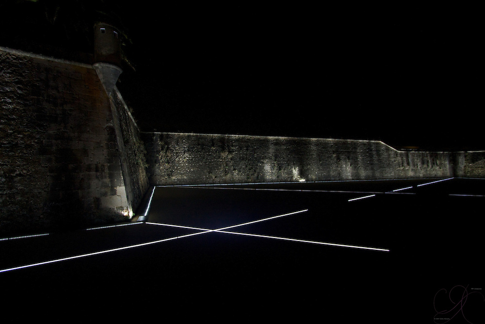 The old fortress walls of the Cidadela at night in Cascais, bathed in futuristic light