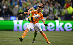 November 30, 2017 - Seattle, Washington, U.S - Soccer 2017: Seattle's GUSTAV SVENSSON (4) defends against Houston's ERICK TORRES (9) as the Houston Dynamo play the Seattle Sounders in the 2nd leg of the MLS Western Conference Finals match at Century Link Field in Seattle, WA. (Credit Image: © Jeff Halstead via ZUMA Wire)