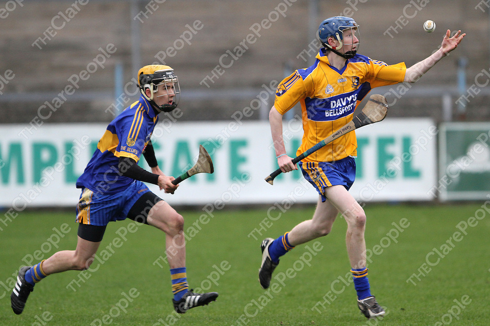 Sixmilbridge's Sean Lynch about to gathe possession ahead of newmarket's Evan Keogh during the Minor A Final. - Photograph by Flann Howard