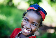 Quite possibly the loveliest smile in Africa. I'm sure she had a beautiful name too, unfortunately I never had the chance to find out. Simple projects developed with local people do make a difference. This little girl has benefited from a simple irrigation scheme giving her family three harvests each year. <br /> <br /> Sodo district, Ethiopia