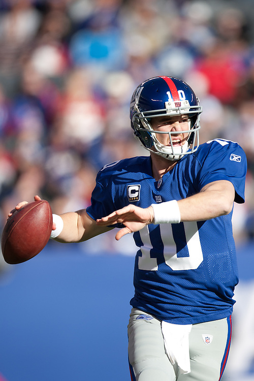 EAST RUTHERFORD, NJ - NOVEMBER 28: New York Giants quarterback Eli Manning #10 passes against the Jacksonville Jaguars on November 28, 2010 at the New Meadowlands Stadium in East Rutherford, New Jersey.The Giants defeated the Jaguars 24 to 20. (Photo by Rob Tringali) *** Local Caption *** Eli Manning