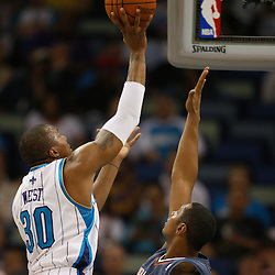Apr 07, 2010; New Orleans, LA, USA; New Orleans Hornets forward David West (30) shoots over Charlotte Bobcats forward Boris Diaw (32) during the first half at the New Orleans Arena. Mandatory Credit: Derick E. Hingle-US PRESSWIRE