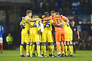 Bristol Rovers players huddle together before the start of the game during the EFL Sky Bet League 1 match between Portsmouth and Bristol Rovers at Fratton Park, Portsmouth, England on 19 February 2019.