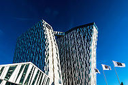 Close-up shot of The Bella Sky Hotel, part of the Bella Center in Copenhagen, against a blue sky on a sunny day in Denmark.