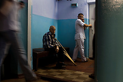 Patients and staff wait outside of the X-Ray room at the TB hospital in Balti.