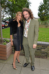 JAMIE BYNG and AZZI GLASSER at an Evening at The River Cafe in aid of the NSPCC held at The River Cafe, Thames Wharf, Rainville Road, London on 19th June 2016