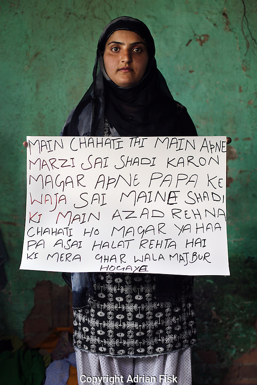Rabia Shebu - 20 yrs.Kashmir.Muslim.Housewife with one child. Husband studying at college..Urdu - 'My wish was to marry a person of my choice. But because of my father I had to marry. I want to be free. But due to the prevailing situation my family was forced.'