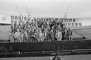 Owen Briscoe, General Secretary of the Yorkshire Area National Union of Mineworkers with dockers and Danish seamen on the ship Libra at Hull docks. They had been unloading food sent by Socialist countries for striking miners' families. 13 October 1984
