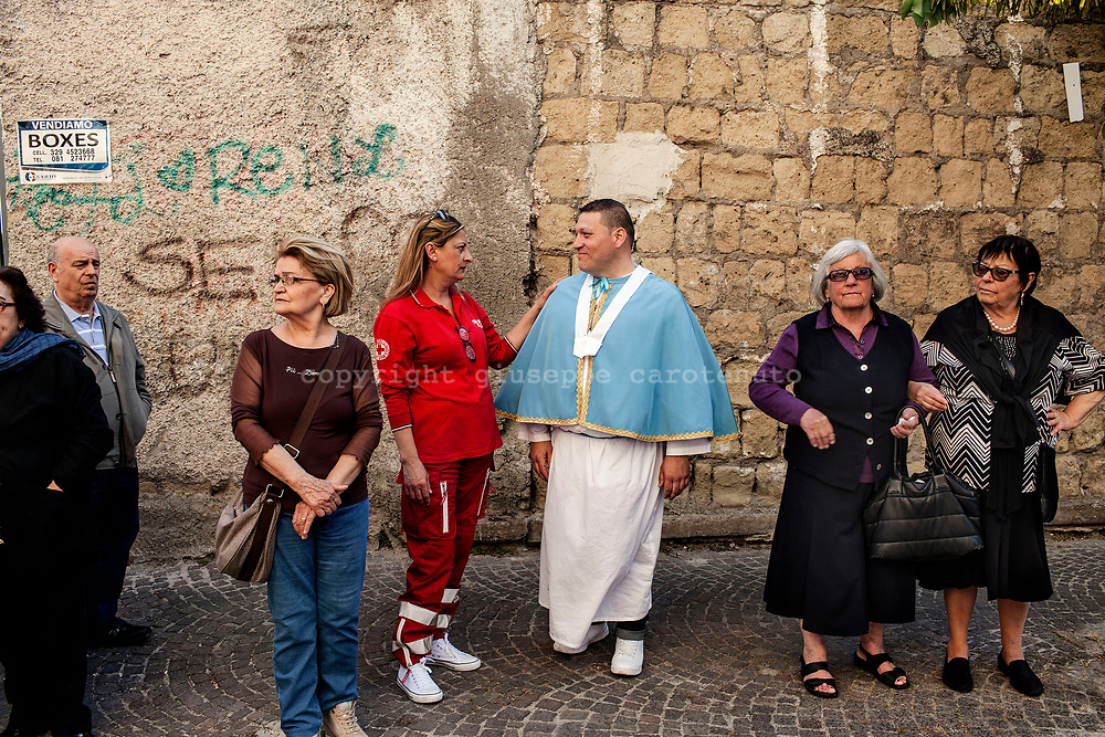 21 May 2017, San Giorgio a Cremano, Naples Italy - 21 May 2017, San Giorgio a Cremano, Naples Italy -  Inhabitants of San Giorgio a Cremano and a &quot;Portancuollo&quot; in the street during the procession of the &quot;Festa della Lava&quot;. San Giorgio Martire is the saint patron and protector of the city of San Giorgio in Cremano. Every year the inhabitants of San Giorgio a Cremano meets in a religious procession of thanks giving to San Giorgio Martire and Immacolata for having stopped the lava during the eruptions of Vesuvius in 1855, 1872 and the last eruption of 1944.<br /> <br /> San Giorgio a Cremano is located in the red zone instituted by Italian Government for the national evacuation plan in case of eruption of the Vesuvio.