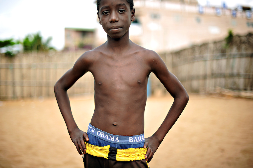 12-03-03  --  ANEHO, TOGO  -- A youth poses with his Barack Obama underwear in Aneho, Togo on March 3, 2012. Obama's name makes appearances on everything from hotels, rice, schools and even villages. Photo by Daniel Hayduk