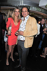 GERRY FOX and JOSIE FOX at a party to celebrate the launch of Jax Coco - a new soft drink, held at Harvey Nichols 5th Floor Bar, 109-125 Knightsbridge, London on 25th June 2012.